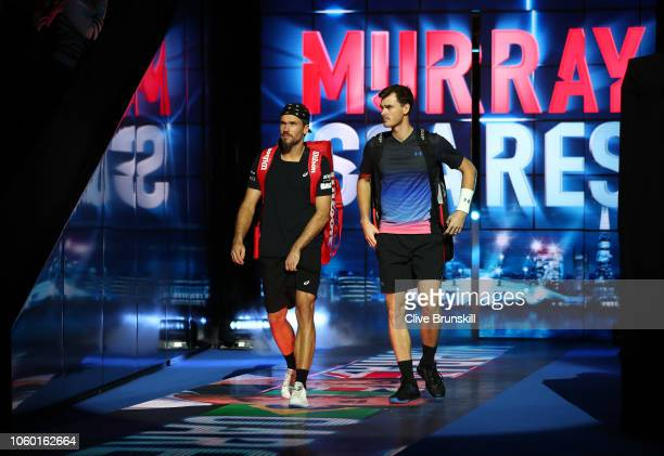 Bruno Soares of South Africa and Jamie Murray of Great Britain walk onto the court ahead of their match against Michael Venus of New Zealand and...
