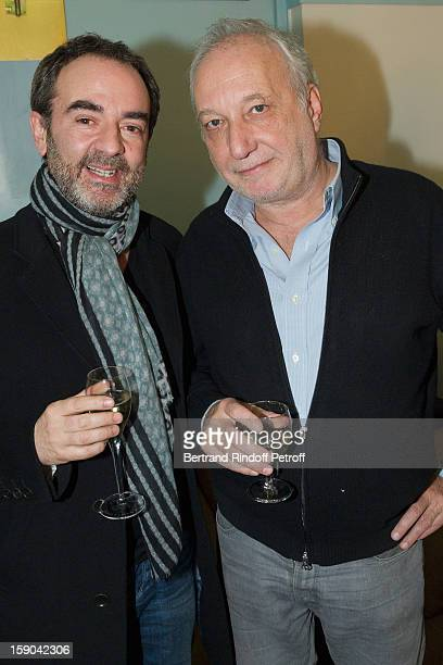 Bruno Solo (L) and Francois Berleand pose after attending the show of French impersonator Laurent Gerra at Olympia hall on January 5, 2013 in Paris, France.