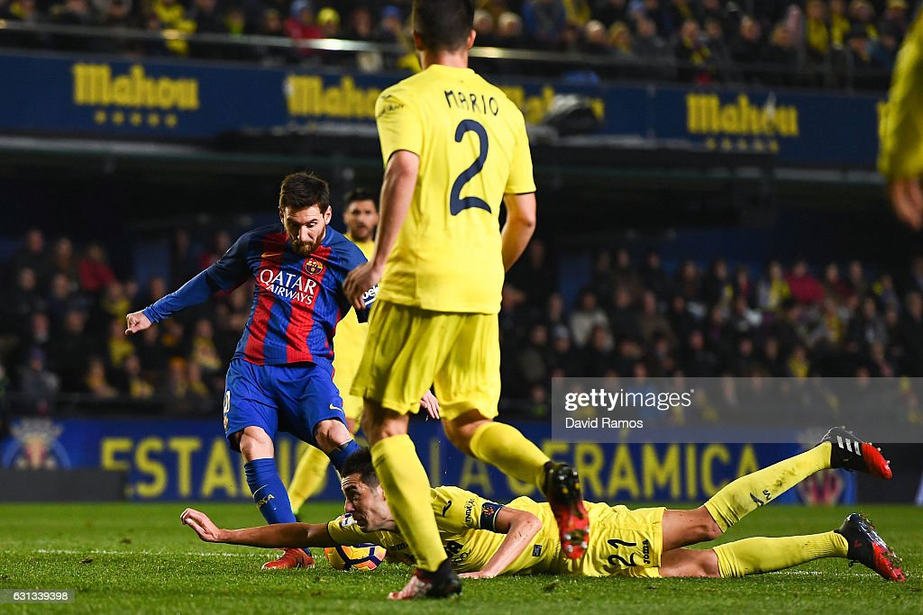 Bruno Soriano of Villarreal CF blocks the ball with his hand as Lionel Messi of FC Barcelona shoots towards goal during the La Liga match between Villarreal CF and FC Barcelona at Estadio de la Ceramica stadium on January 8, 2017 in Villarreal, Spain.