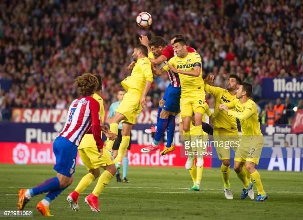 Bruno Soriano of Villarreal CF defends from a corner kick during the La Liga match between Club Atletico de Madrid and Villarreal CF at estadio...
