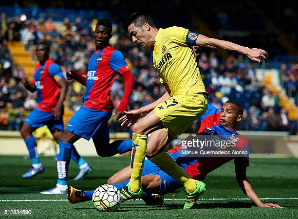 Bruno Soriano of Villarreal is tackled by Deyverson of Levante during the La Liga match between Villarreal CF and Levante UD at El Madrigal on...