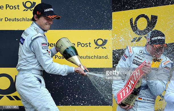 Bruno Spengler of Canada and Mercedes Benz Bank AMG Mercedes celebrates with third placed Ralf Schumacher of Germany and Salzgitter AMG Mercees after...