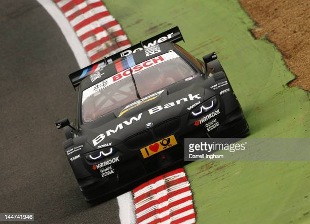 Bruno Spengler of Canada drives the BMW Team Schnitzer BMW M3 DTM during practice for the DTM German Touring Car Championship race at the Brands...