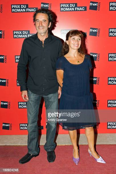 Bruno Todeschini and Ariane Ascaride attend the Prix Du Roman Fnac 2012 at Theatre Marigny on August 28 2012 in Paris France