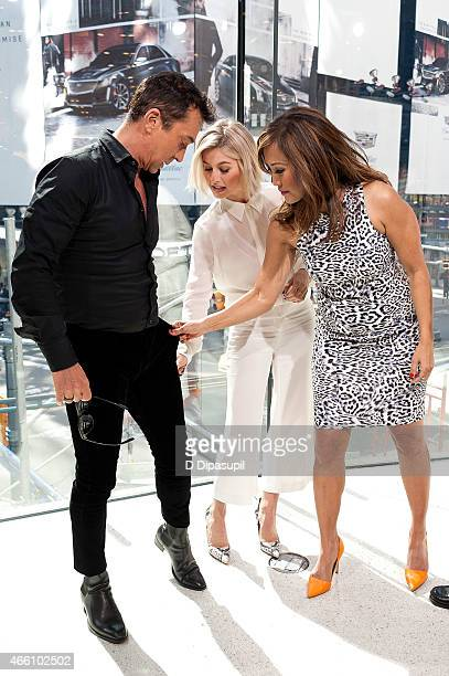 """Bruno Tonioli, Julianne Hough, and Carrie Ann Inaba visit """"Extra"""" at their New York studios at H&M in Times Square on March 13, 2015 in New York City."""