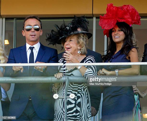 Bruno Tonioli Julie Cowell and Jackie St Clair watch the racing as they attend Royal Ascot Ladies Day at Ascot Racecourse on June 17 2010 in Ascot...