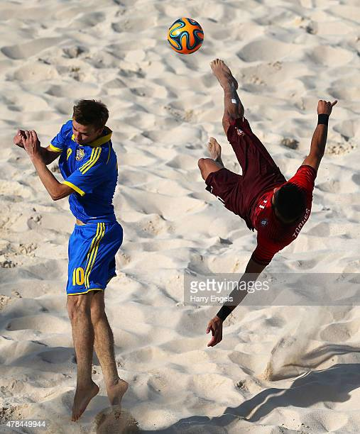 Bruno Torres of Portugal and Dmytro Medved of Ukraine battle for the ball during the Men's Beach Soccer Group A match between Portugal and Ukraine on...