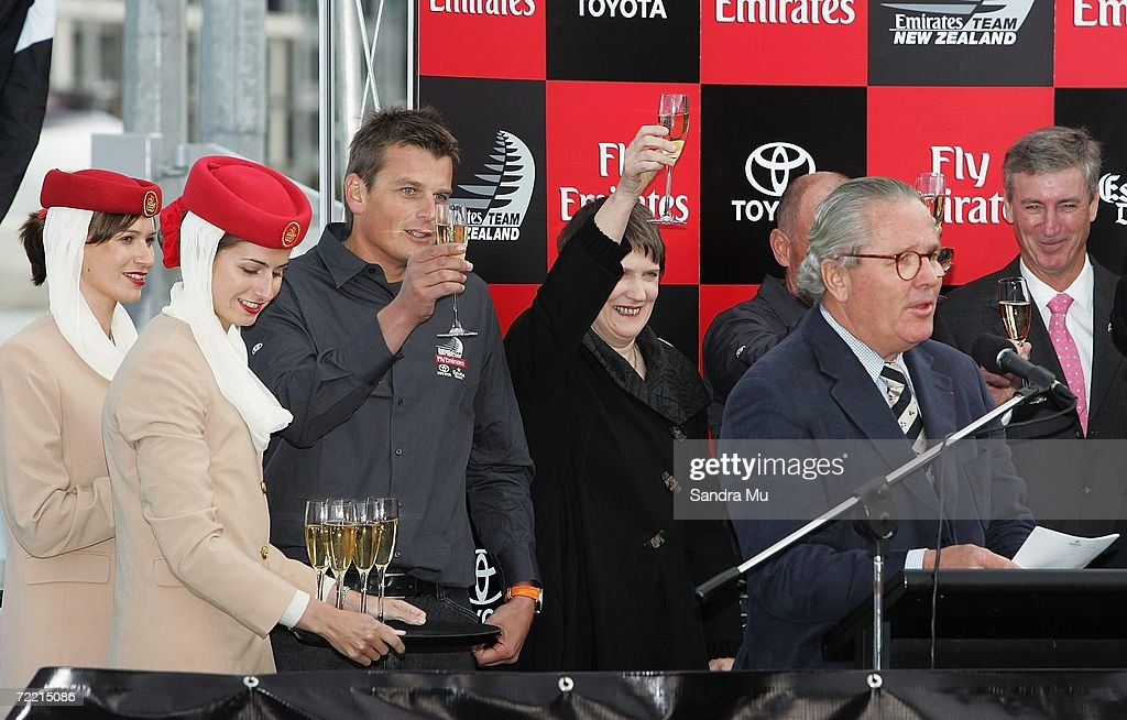 Bruno Trouble (2nd R) toasts the new boat as skipper Dean Barker (3rd L) and Prime Minister Helen Clark raise their glasses during the Team New Zealand America's Cup boat launch at Viaduct Harbour on October 19, 2006 in Auckland, New Zealand.