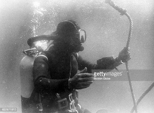 Bruno Vailati holds a line while going through decompression time after diving to the Andrea Doria 45 miles off the coast of Nantucket Mass on July...