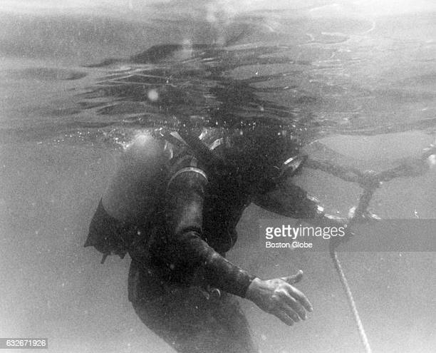 Bruno Vailati pulls the signal line connected to the marker buoy after diving to the Andrea Doria 45 miles off the coast of Nantucket Mass on July 27...