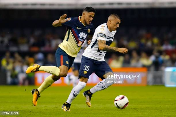 Bruno Valdez of America and Nicolas Castillo of Pumas fight for the ball during the 3rd round match between America and Pumas UNAM as part of the...