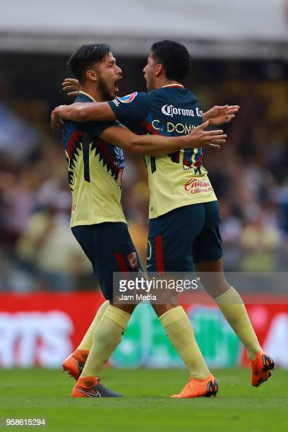 Bruno Valdez of America celebrates with teammate Cecilio Dominguez after scoring the second goal of his team during the semifinals second leg match...