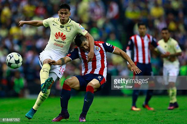 Bruno Valdez of America fights for the ball with Alan Pulido of Chivas during the semifinal match between America and Chivas as part of the Copa MX...