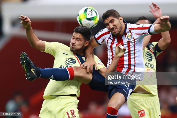Bruno Valdez of America struggles for the ball with Jair Pereira of Chivas during the quarterfinals match between America and Chivas as part of the...