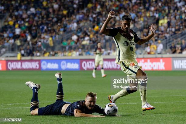 Bruno Valdez of Club America fouls Kacper Przybyłko of Philadelphia Union for a penalty during the second half during the semifinal second leg match...