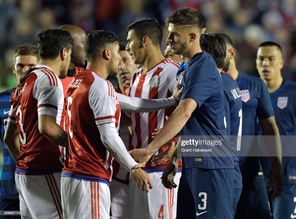 Bruno Valdez #5 of Paraguay and Matt Miazga #3 of United States exchange angey words as the teams scuffle during their game at WakeMed Soccer Park on March 27, 2018 in Cary, North Carolina. The United States won 1-0.