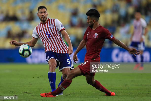 Bruno Valdez of Paraguay and Tarek Salman of Qatar compete for the ball during the Copa America Brazil 2019 group B match between Paraguay and Qatar...