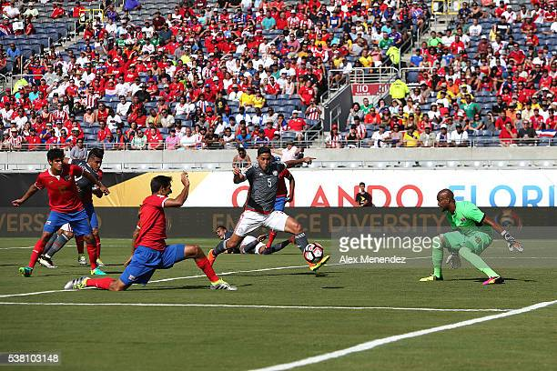 Bruno Valdez of Paraguay attempt a shot on goal against Patrick Pemberton of Costa Ricaduring the 2016 Copa America Centenario Group A match between...