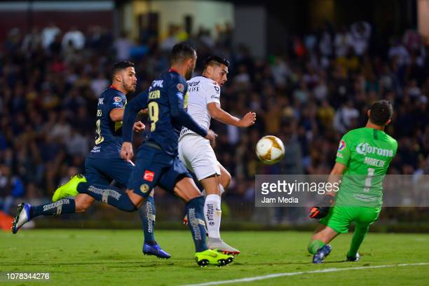 Bruno Valdez Victor Aguilera and Agustin Marchesin of America fight for the ball with Felipe Mora del Pumas during the semifinal first leg match...