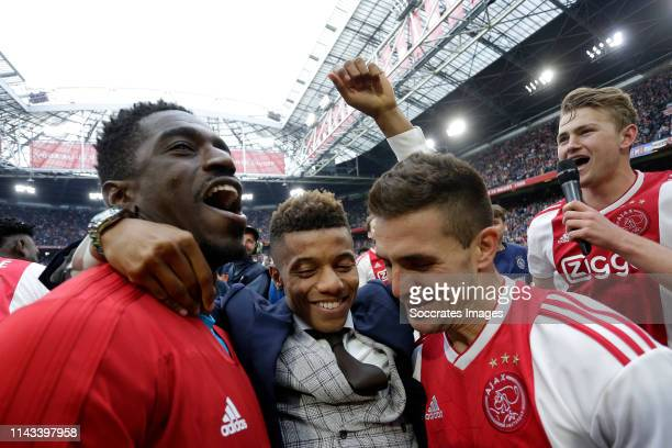 Bruno Varela of Ajax David Neres of Ajax Dusan Tadic of Ajax celebrates the victory during the Dutch Eredivisie match between Ajax v FC Utrecht at...