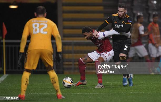 Bruno Viana of SC Braga with Matt Doherty of Wolverhampton Wanderers in action during the Group K UEFA Europa League match between SC Braga and...