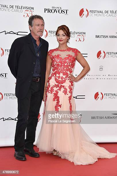 Bruno Wolkowitch and Priscilla Betti arrive at the opening ceremony of the 55th Monte Carlo TV Festival on June 13 2015 in MonteCarlo Monaco