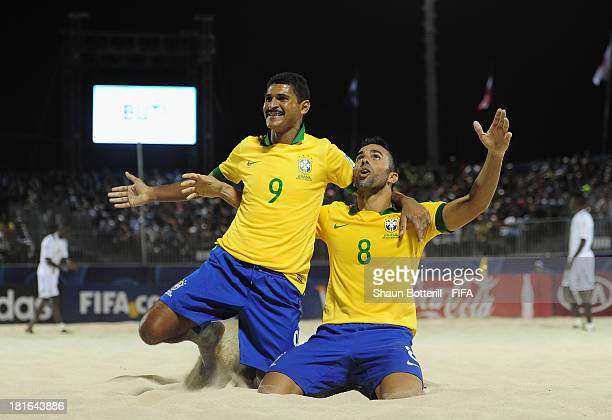 Bruno Xavier and Andre of Brazil celebrate during the FIFA Beach Soccer World Cup Tahiti 2013 Group C match between Brazil and Senegal at the Tahua...