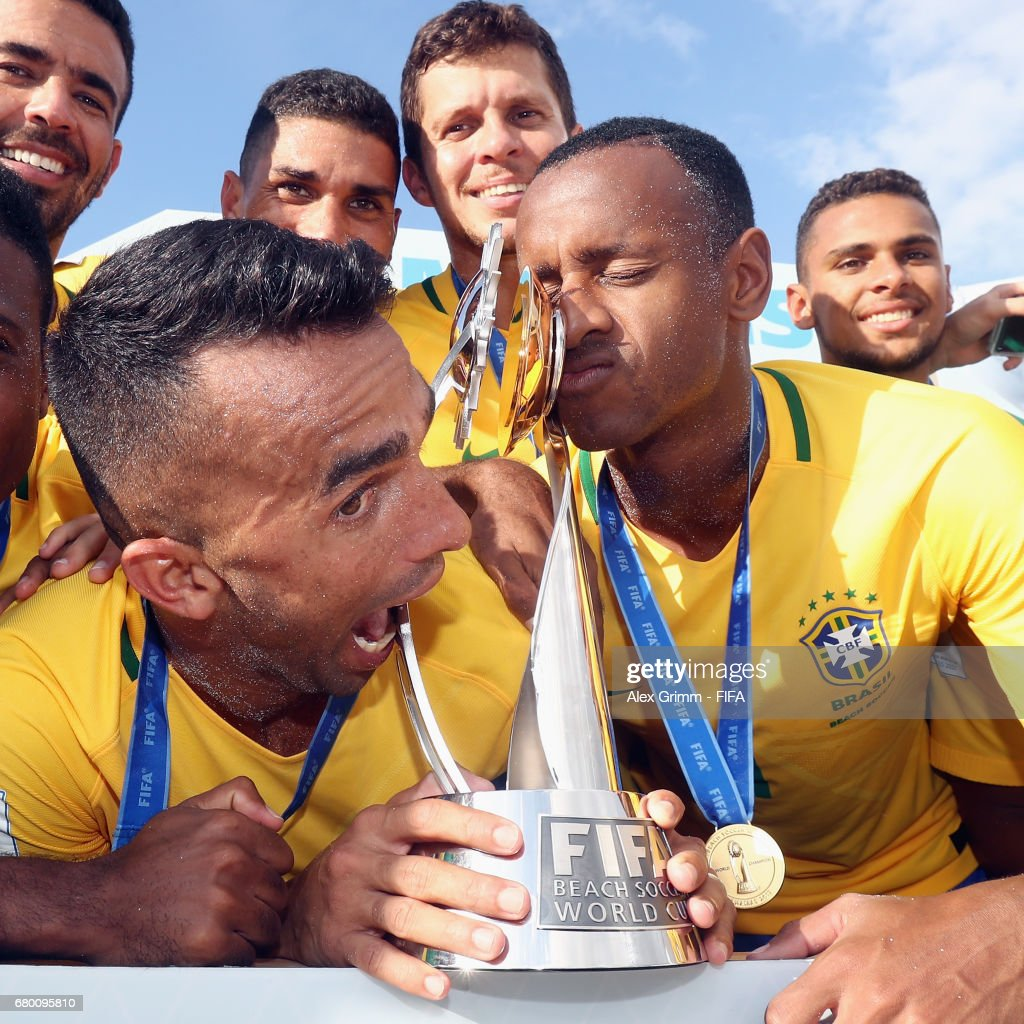 Bruno Xavier and Catarino of Brazil pose with the trophy after their team won the FIFA Beach Soccer World Cup Bahamas 2017 final between Tahiti and Brazil at National Beach Soccer Arena at Malcolm Park on May 7, 2017 in Nassau, Bahamas.
