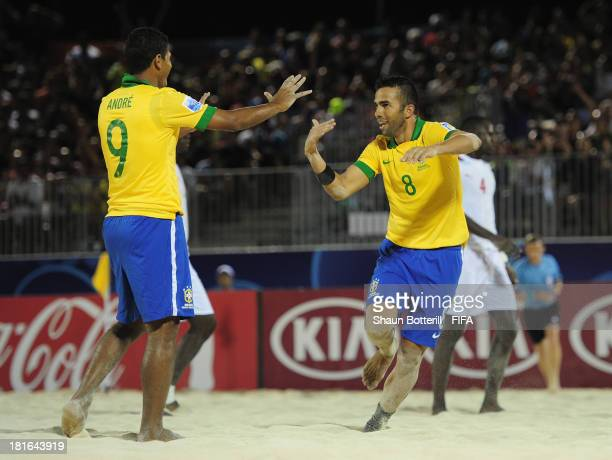 Bruno Xavier of Brazil celebrates with teammate Andre after scoring during the FIFA Beach Soccer World Cup Tahiti 2013 Group C match between Brazil...