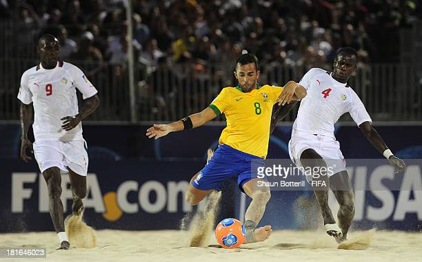 Bruno Xavier of Brazil is challenged by Papa Ndour of Senegal during the FIFA Beach Soccer World Cup Tahiti 2013 Group C match between Brazil and...