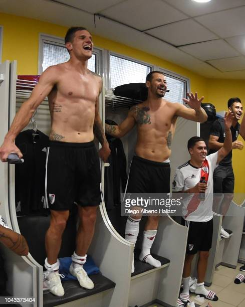 Bruno Zuculini and Rodrigo Mora of River Plate celebrate in the visitor's dressing room after a match between Boca Juniors and River Plate as part of...