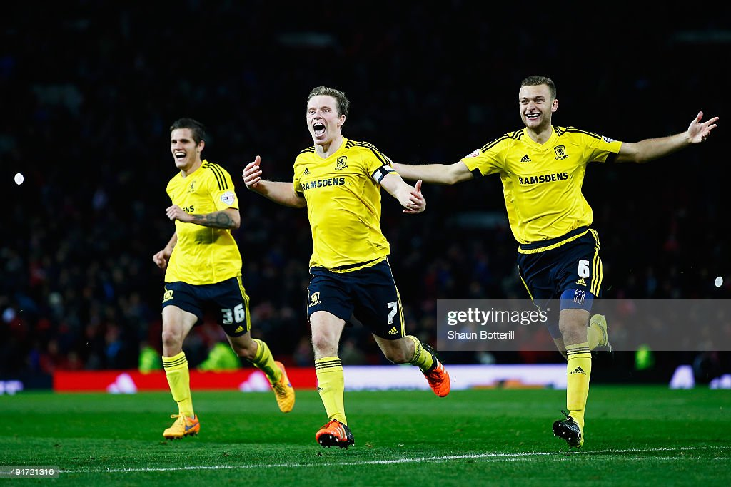 Bruno Zuculini, Grant Leadbitter and Ben Gibson of Middlesbrough celebrate victory after the penalty shoot out during the Capital One Cup Fourth Round match between Manchester United and Middlesbrough at Old Trafford on October 28, 2015 in Manchester, England.