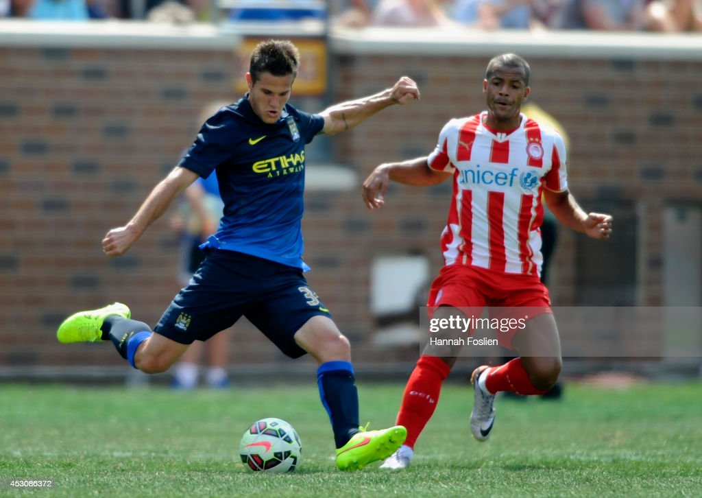Bruno Zuculini #36 of Manchester City controls the ball Mathieu Dossevi #77 of Olympiacos of the International Champions Cup match in the second half on August 2, 2014 at TCF Bank Stadium in Minneapolis, Minnesota. The Olympiacos defeated the Manchester City in a penalty shootout.