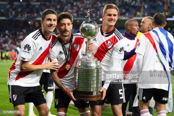Bruno Zuculini of River Plate and his teammates celebrate with the trophy at the end of the second leg of the final match of Copa CONMEBOL...