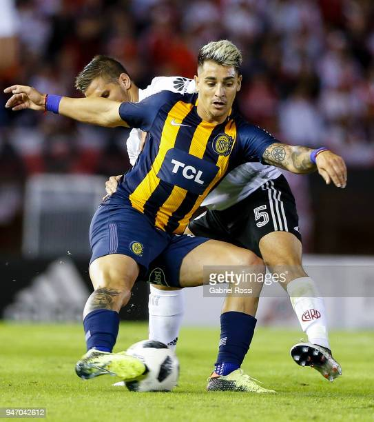 Bruno Zuculini of River Plate fights for the ball with Fernando Zampedri of Rosario Central during a match between River Plate and Rosario Central as...