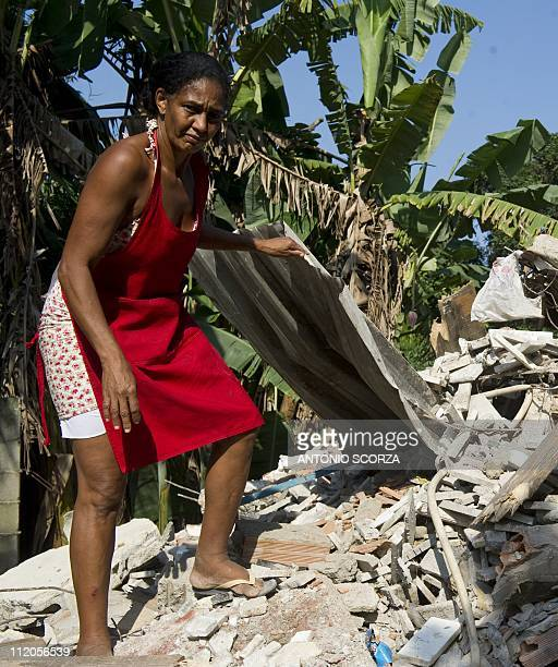 BRUNOBrazilian Selvita Rufino tries to retrieve her belongings from the debris of her house demolished to give way to the Transoeste road on April 8...
