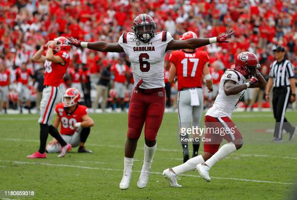 J Brunson and Jaycee Horn of the South Carolina Gamecocks react after a missed field goal by Rodrigo Blankenship of the Georgia Bulldogs in second...