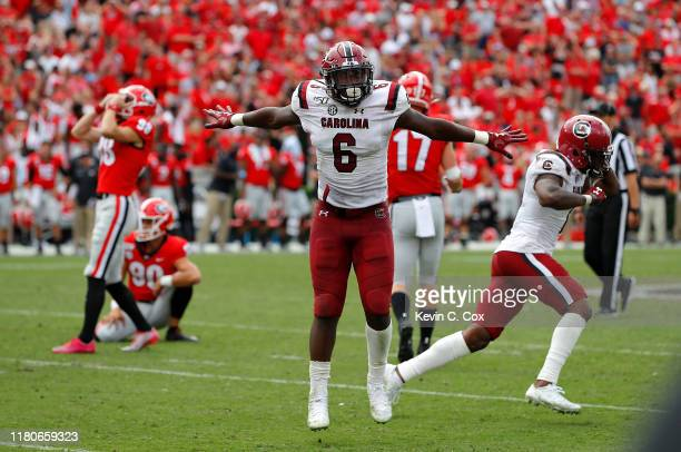 Brunson and Jaycee Horn of the South Carolina Gamecocks react after a missed field goal by Rodrigo Blankenship of the Georgia Bulldogs in second...