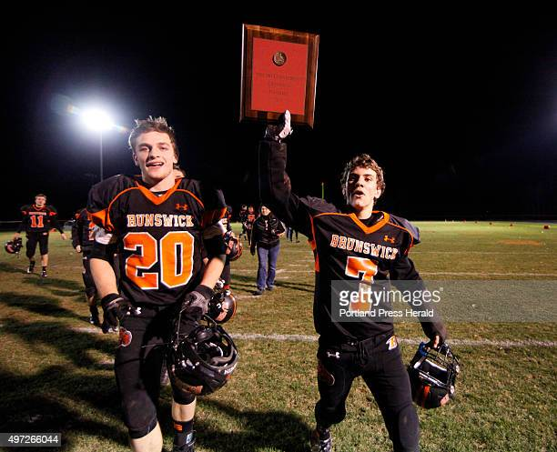 Brunswick Jesse Devereaux and Hunter Garrett show off their winning plaque after defeating Brewer in the Pine Tree Conference at Brunswick in the...