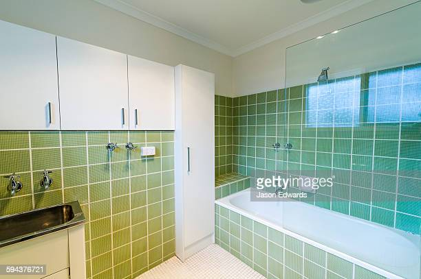 A tiled bathroom and laundry in an inner city apartment.
