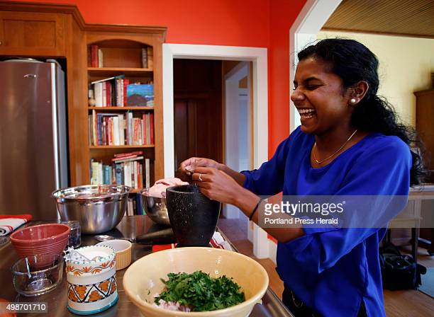 Brunswick resident Michael Sanders makes duck confit with his daughter Lily at their home on Friday October 30 2015 Lily laughs while crushing...