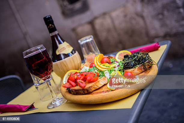 bruschetta and wine - chianti region stock photos and pictures