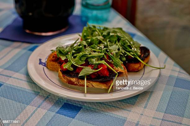 bruschetta in italy - bavosi stock photos and pictures