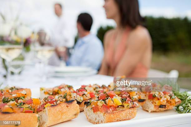 Bruschetta on table at outdoor dinner party