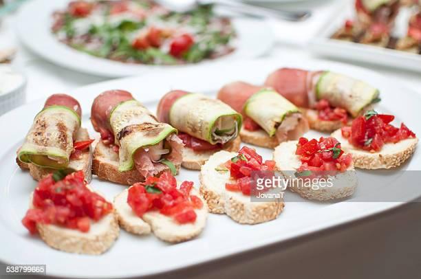 Bruschetta tomato and rolled prosciuto zucchini