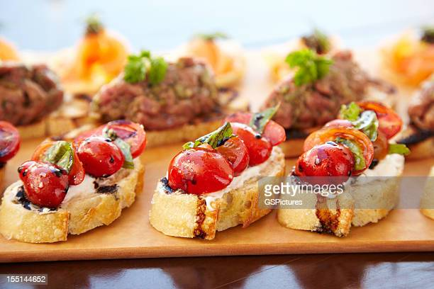 Bruschetta with cheese, tomatoes and foie gras pate
