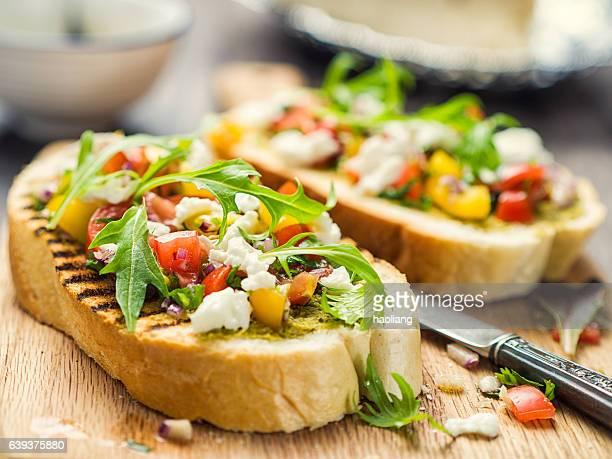 Bruschetta with tomato and rocket