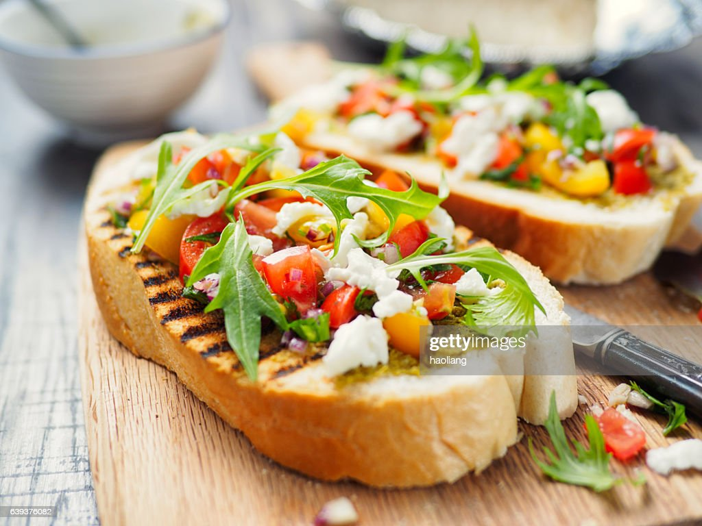 Bruschetta with tomato and rocket : Stock Photo