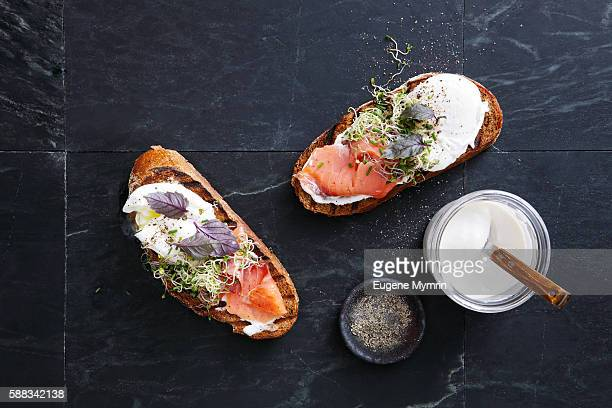 Bruschetta with trout, poached egg, horseradish cream and herbs