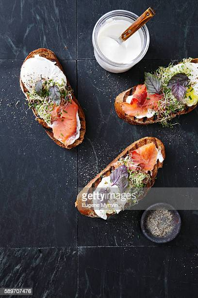 bruschetta with trout, poached egg, horseradish cream and herbs - antipasto stock pictures, royalty-free photos & images